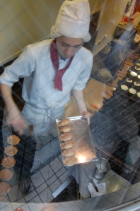 Grilling the Peko-chan cakes